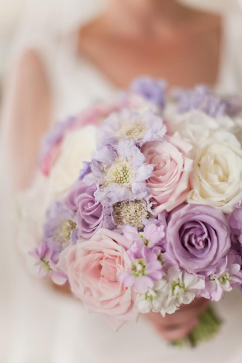 Soft and romantic hand tied mix of scabiosa lavender, roses and stocks