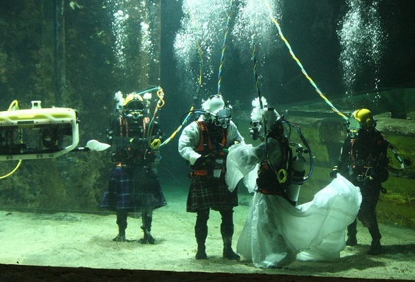 How deep is your love? Couple hold underwater wedding