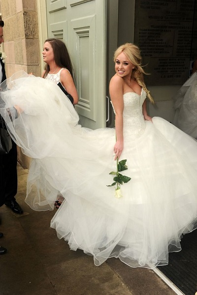Jorgie Porter wears a white wedding dress to Kieron Richardson's wedding