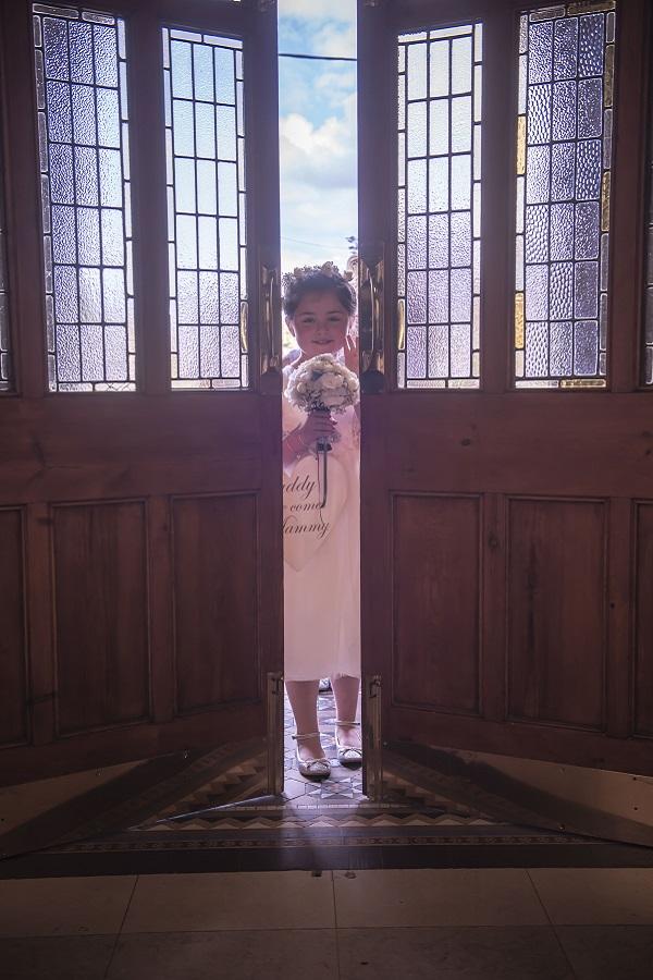 child peaking into church