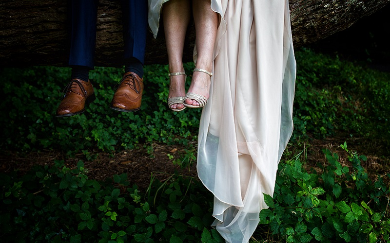 bride and groom feet hanging from tree