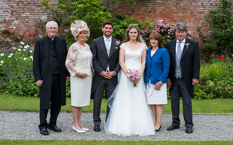 bride and groom with parents