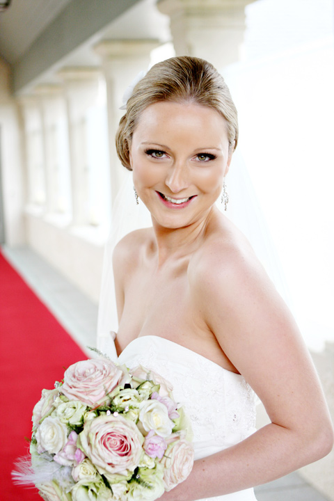 Bride Caroline Givan carries a bouquet by Ivy Lane Florists
