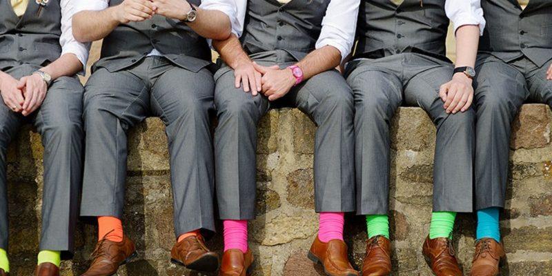 groomsmen on a wall