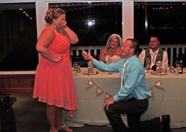 marriage proposal at a wedding