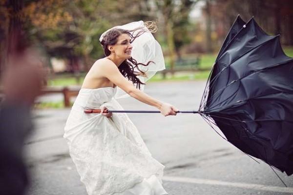 bride being blown away