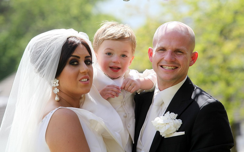 bride, groom and son