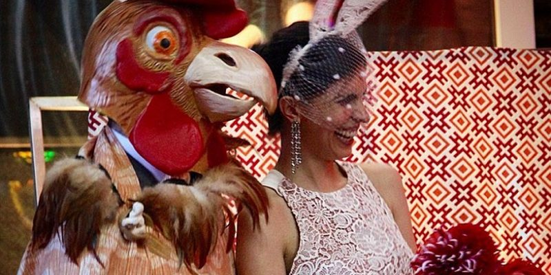 The groom wore a chicken head and the bride wore bunny ears
