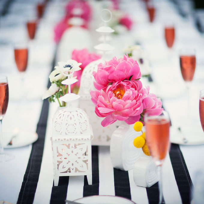 Peonies on a wedding table Brides.com
