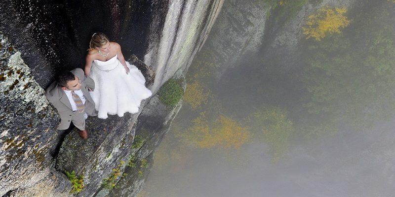 Extreme wedding photos taken on a cliff edge