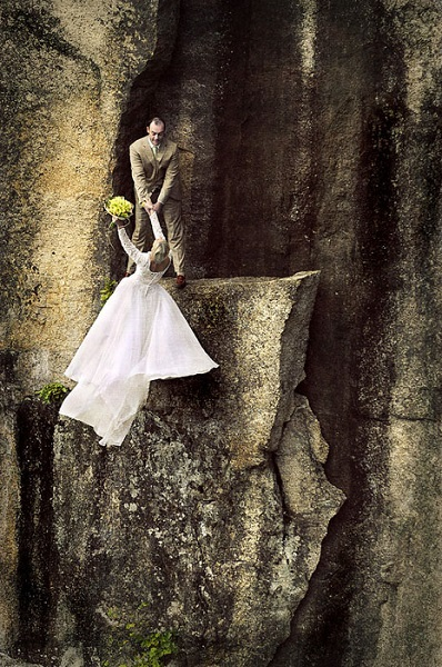 Extreme wedding photos taken on a cliff edge
