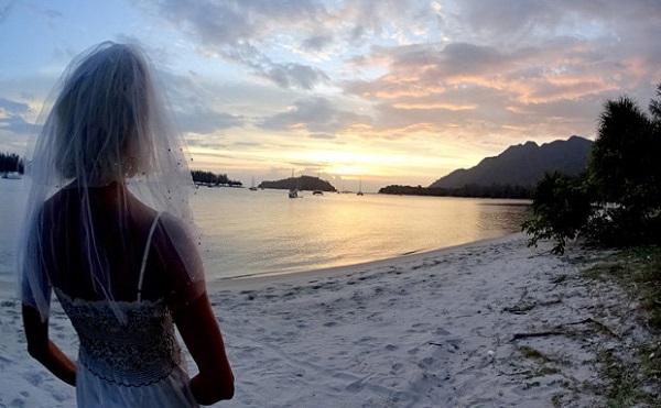 Heartbroken bride travels the world in her wedding dress