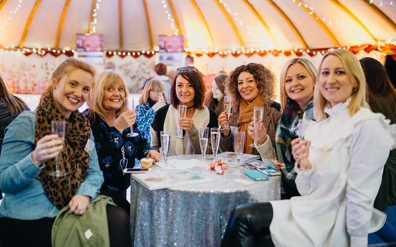 girls in tent with prosecco