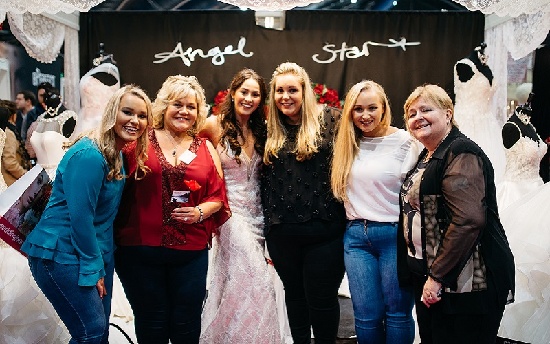 brides outside Angel Star stand at the Wedding Journal Show