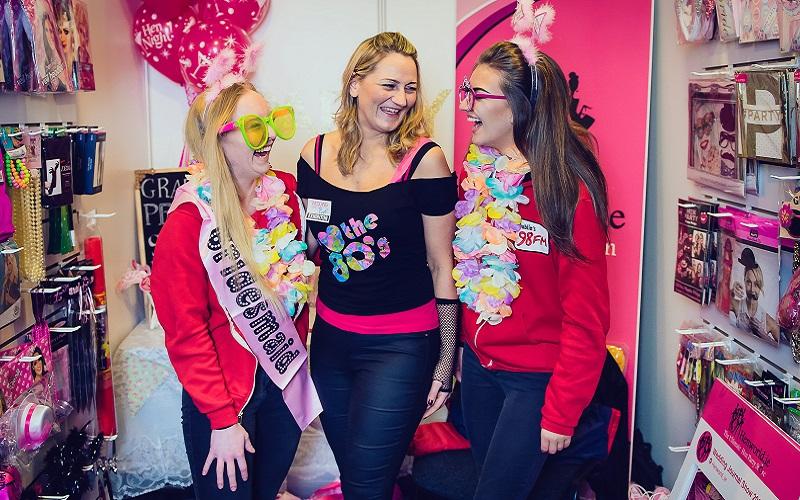 three girls posing at hen party