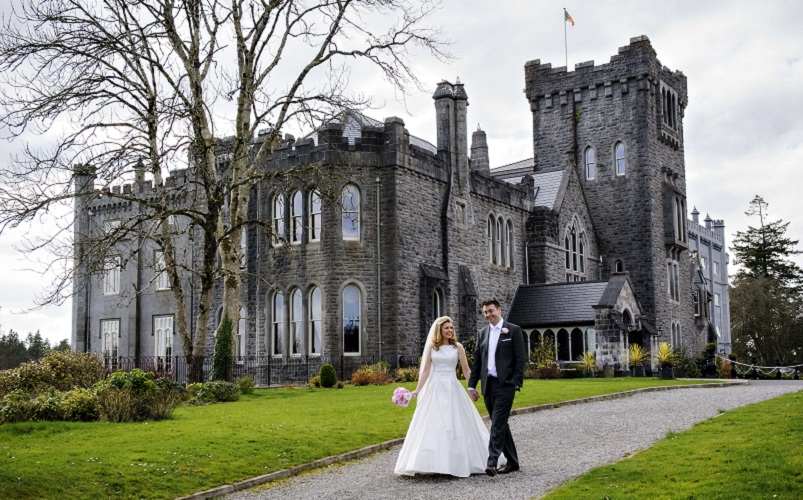 bride and groom with castle