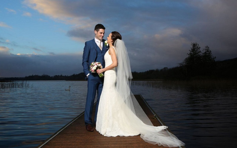 bride and groom on lake