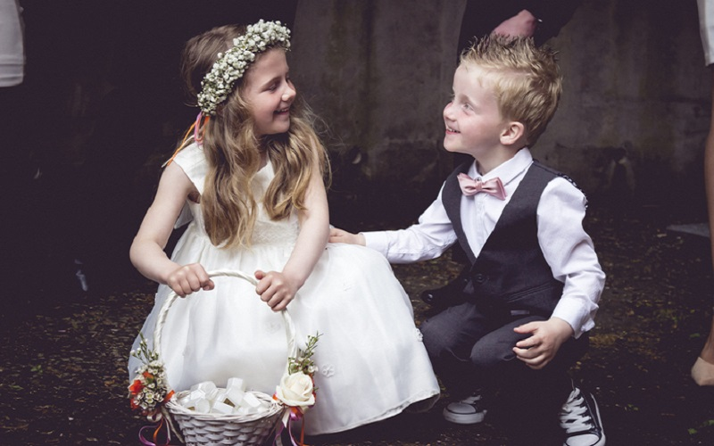 flower girl and page boy laughing