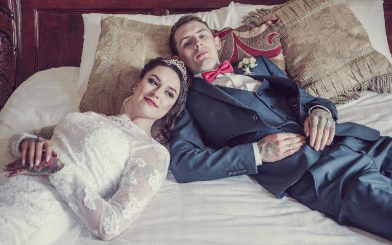 bride and groom lying on bed