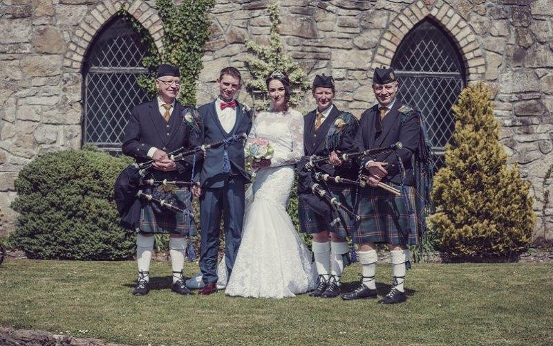 bride and groom and pipe band