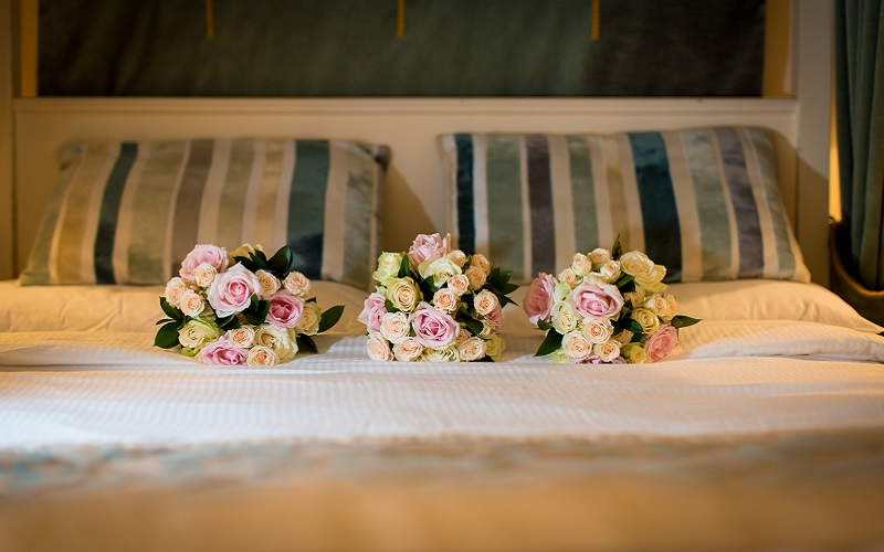 wedding flowers on bed