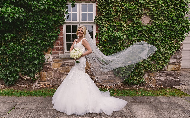 bride with veil in air