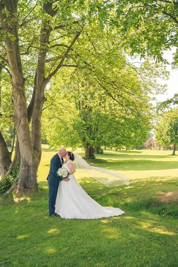Bride and groom in grounds of Edenmore Country Club