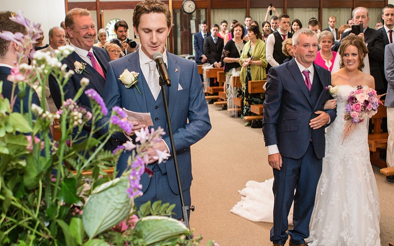 groom singing bride down aisle