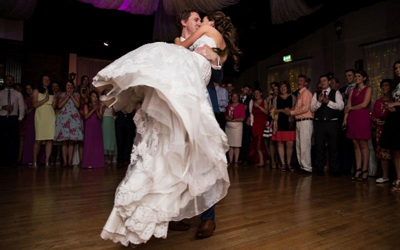 bride and groom twirling on dancefloor