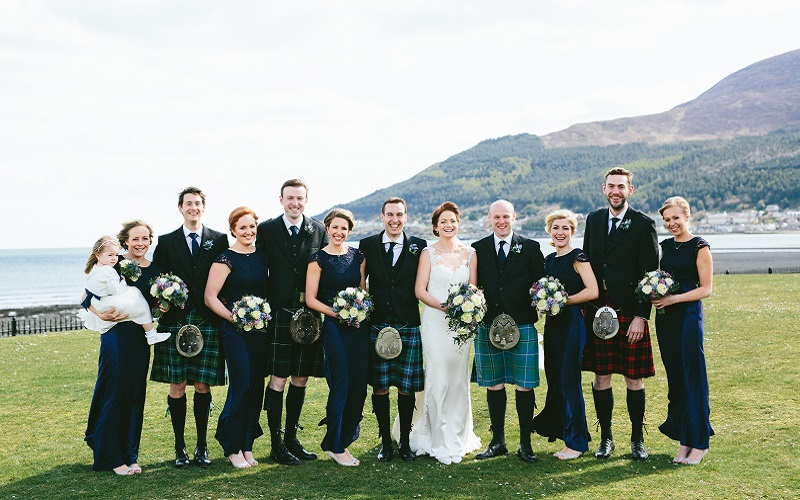 bridal party in front of mountain