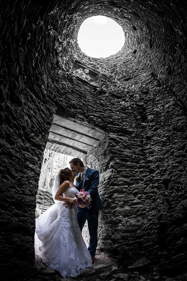 bride and groom in wishing well