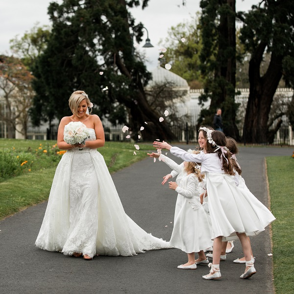 flower girls throwing confetti