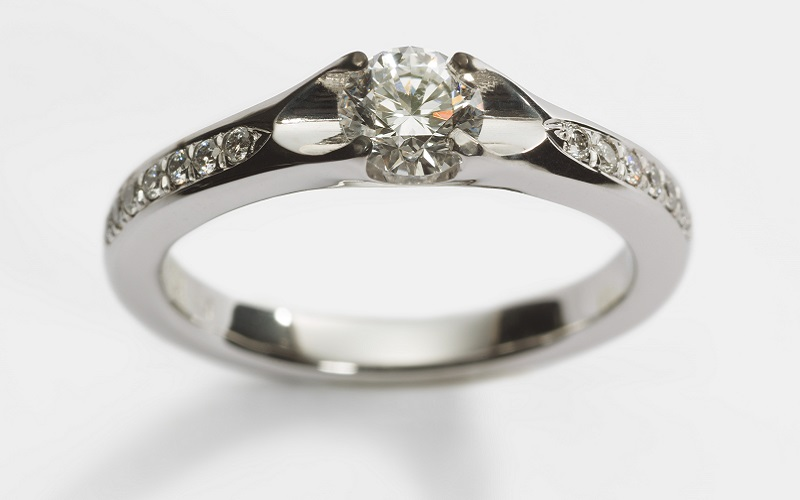 paved solitaire engagement ring