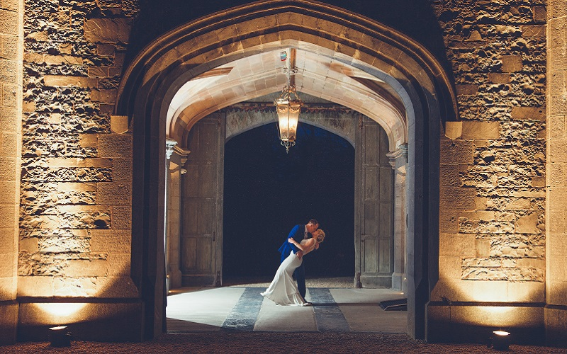 bride and groom in archway at Markress Castle
