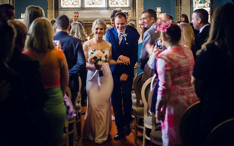 bride and groom walking down aisle Markree Castle