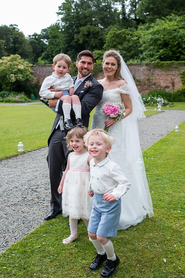 bride and groom with children